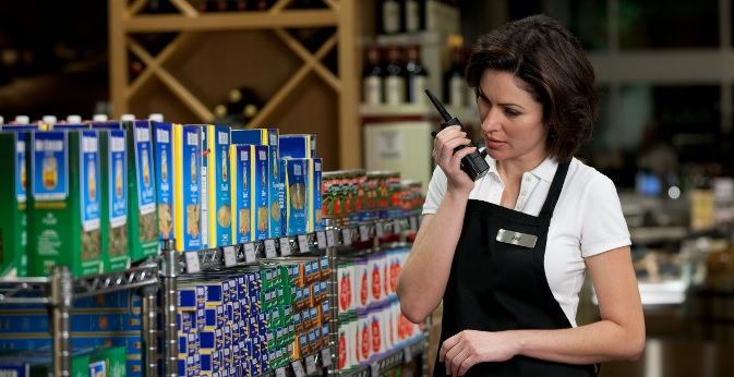 retail store clerk checks inventory uses radio