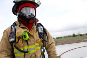 firefighter in gear with two way radio