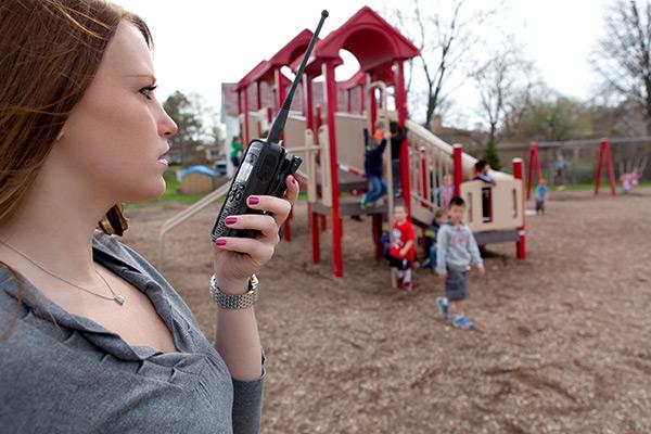 teacher at school playground on two way radio