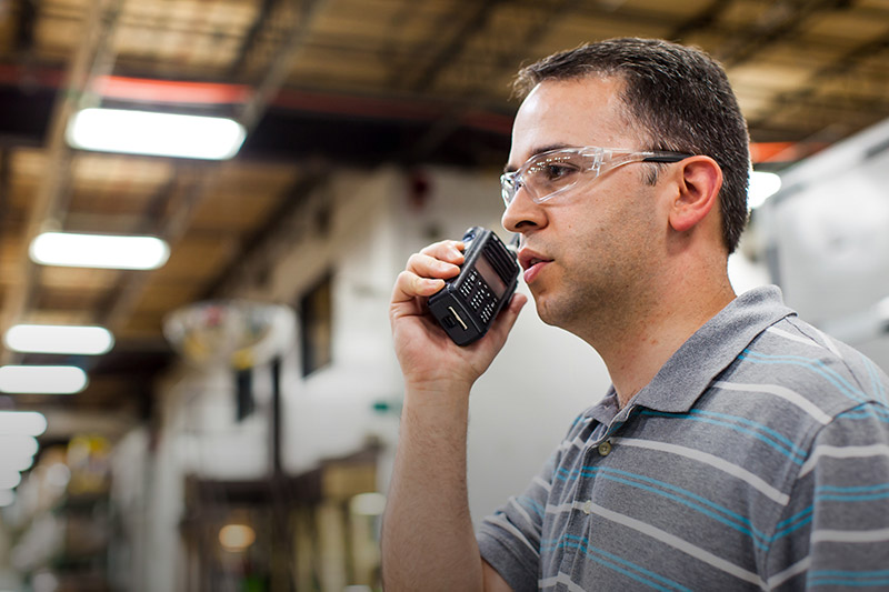 warehouse supervisor on two way radio