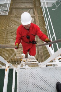 oil worker on rig with radio & mic