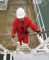 oil rig worker on two way radio