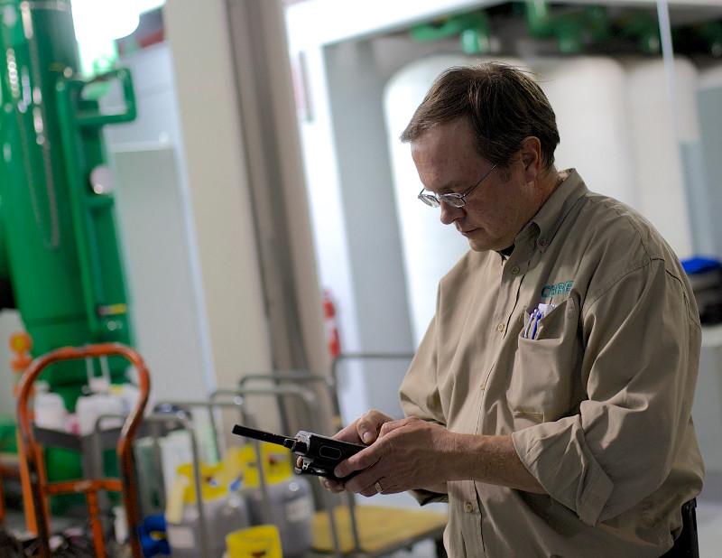 Warehouse worker uses two-way radio