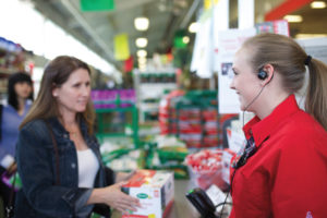 Retail store cashier using two-way radio