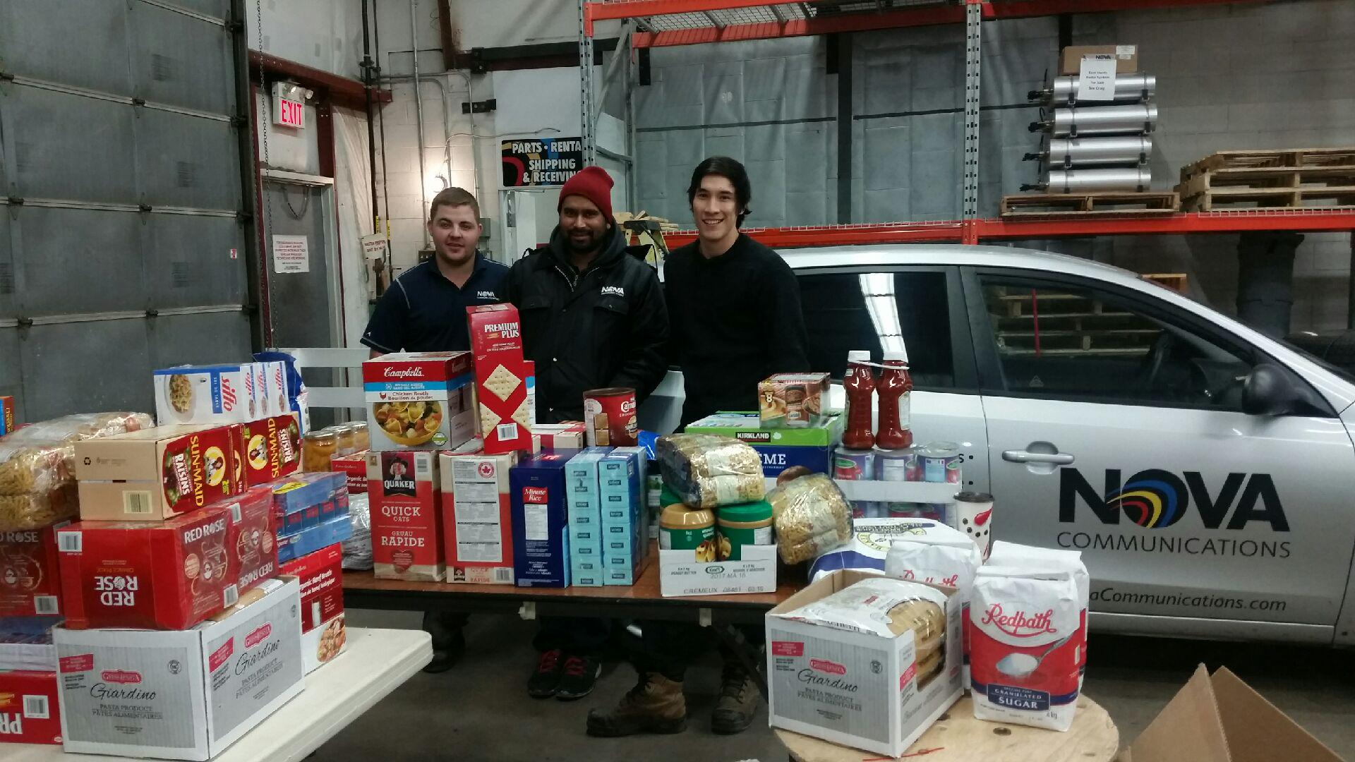 NOVA Communications team donating to food bank