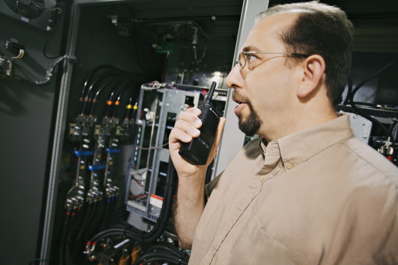 property manager on two-way radio in control room