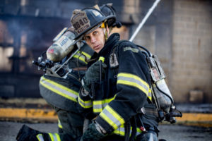 firefighter using two-way radio to communicate