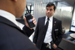 Security officers communicate with Motorola two-way radio