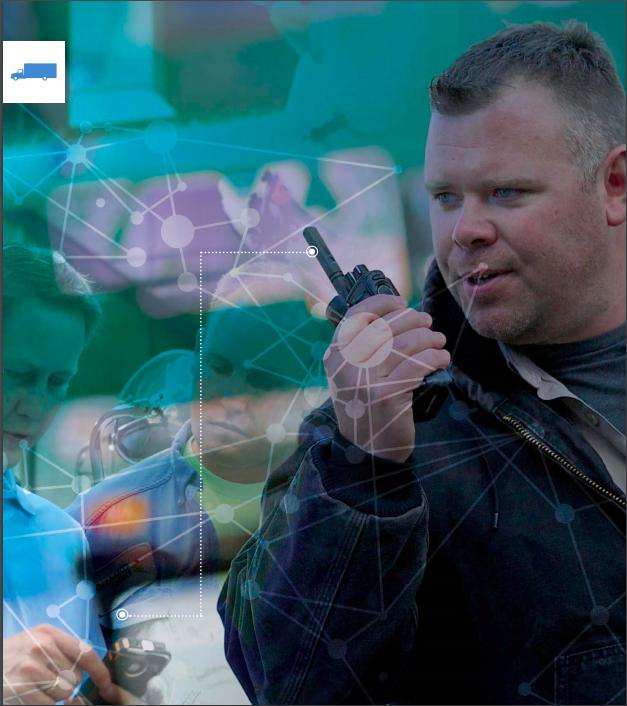 Man using two-way radio at work site