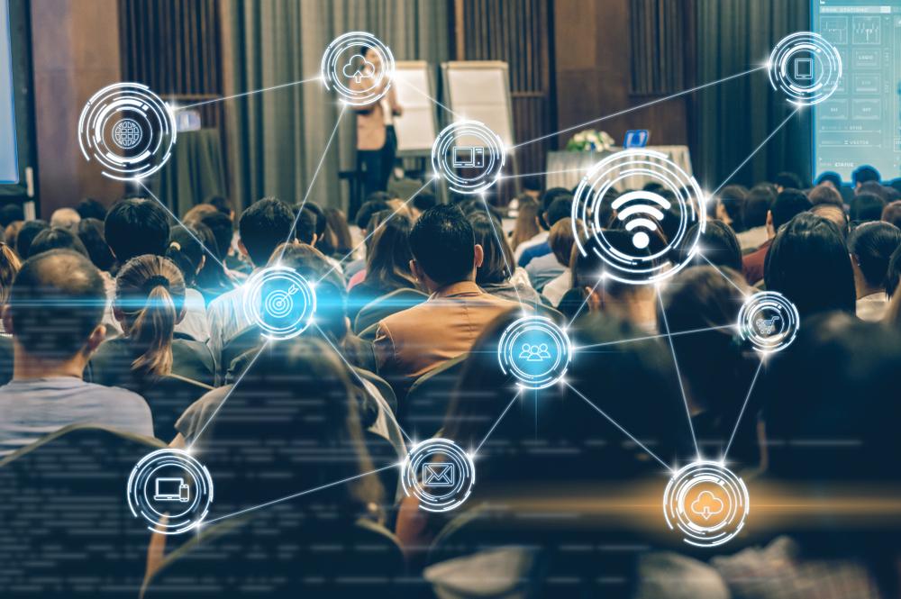 Keynote speaker delivering presentation on wireless networks