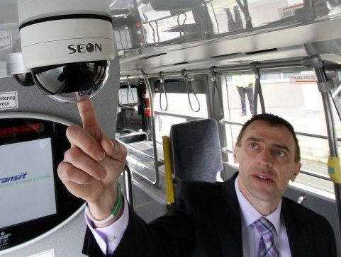 transit supervisor checks security camera on wireless network