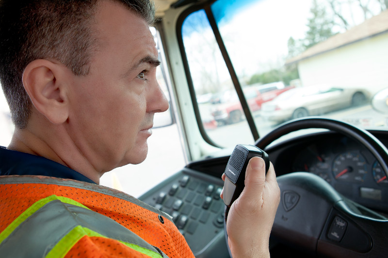 truck driver communicates on two-way radio