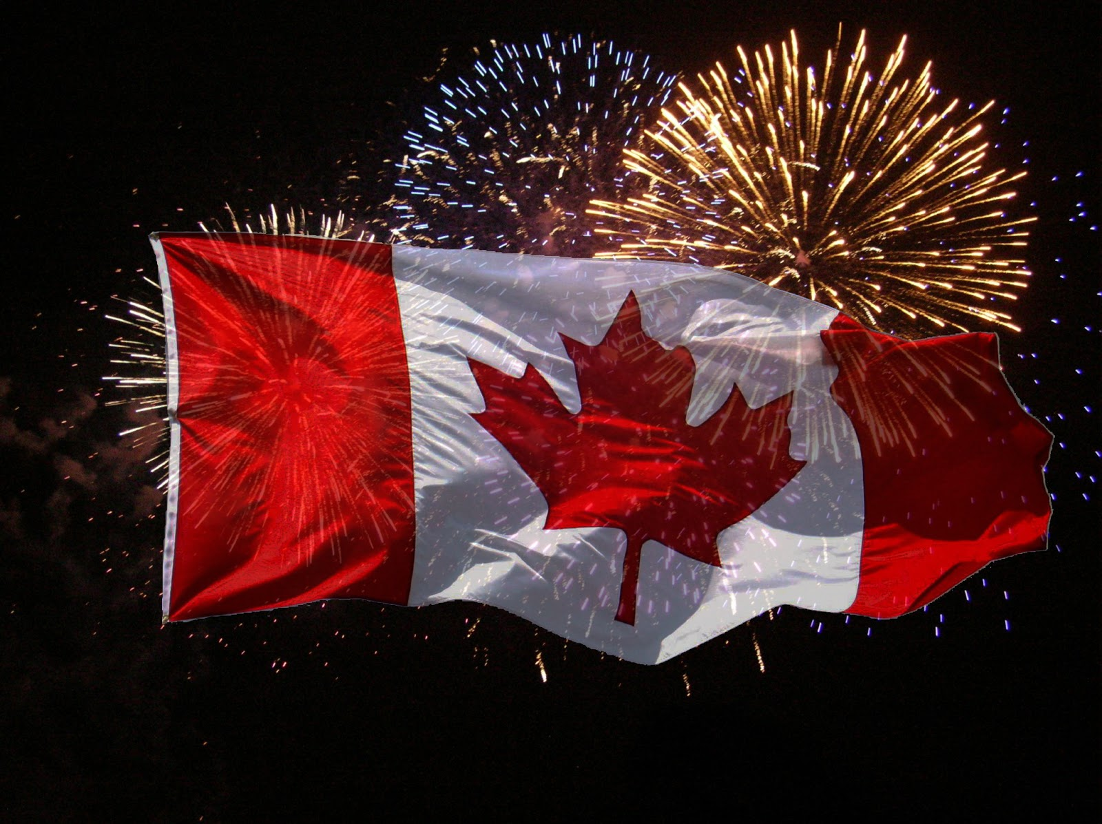 canada flag with fireworks celebrating canada day