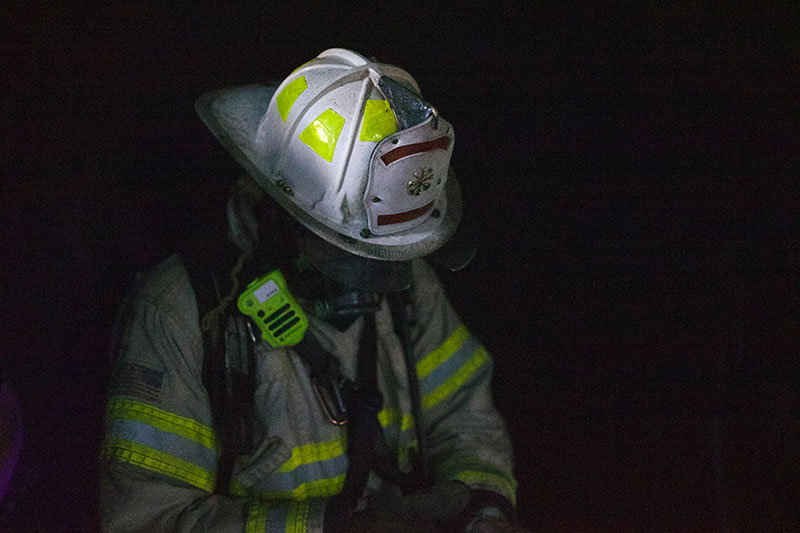 firefighter gear with helmet PPE and two-way radio