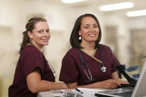 two nurses communicating with mobile device