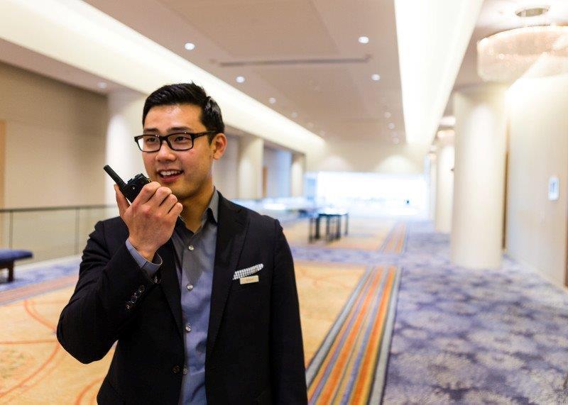 hotel manager communicating on two-way radio