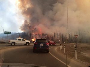 forest fire with roads diverted firefighters on scene