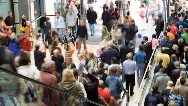 customers in crowded shopping mall
