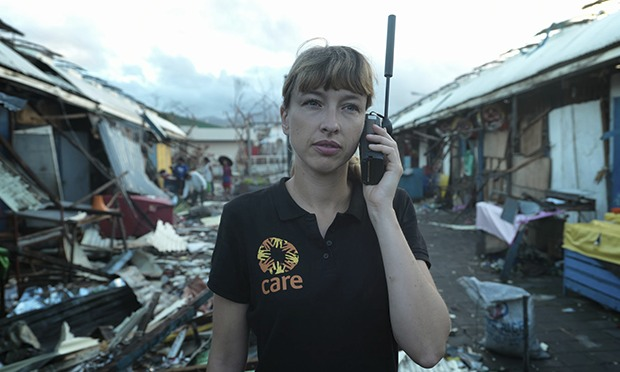 non-profit worker in remote site uses satellite phone