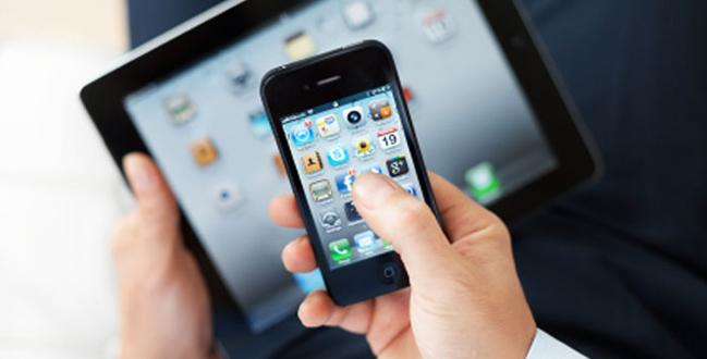 man uses iphone & ipad on wireless network