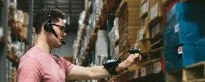 warehouse employee scans boxes with mobile device